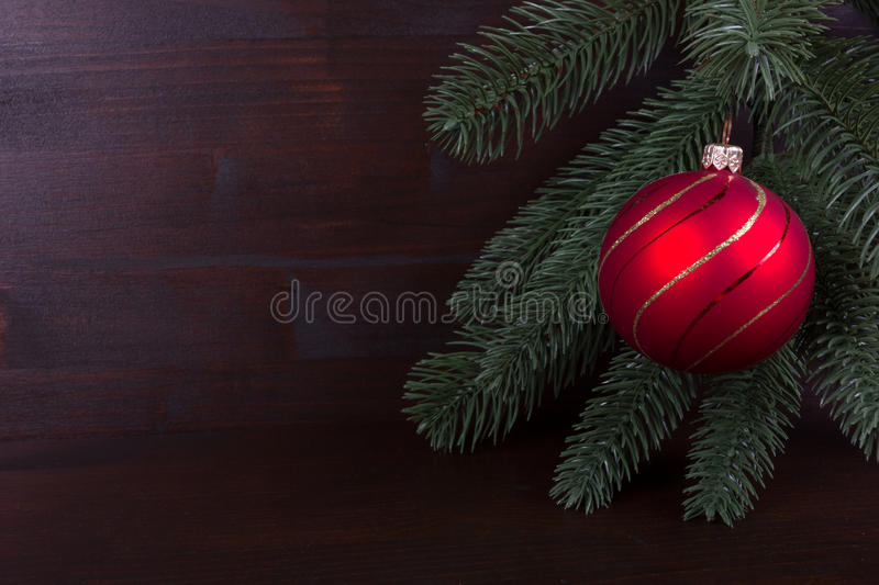 Nostalgic red Christmas ball on dark backgrond royalty free stock images