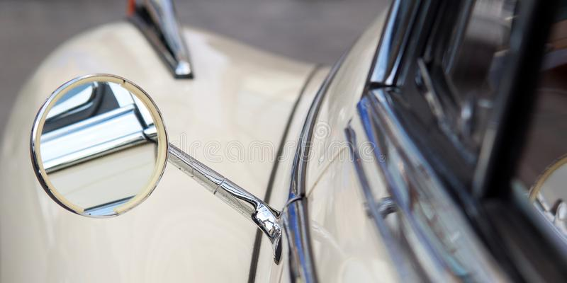 Nostalgic retro car. Vintage car with a funny round rearview mirror stock images