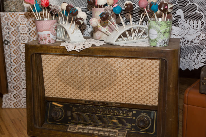 Nostalgic retro radio with Cake pops stock photos