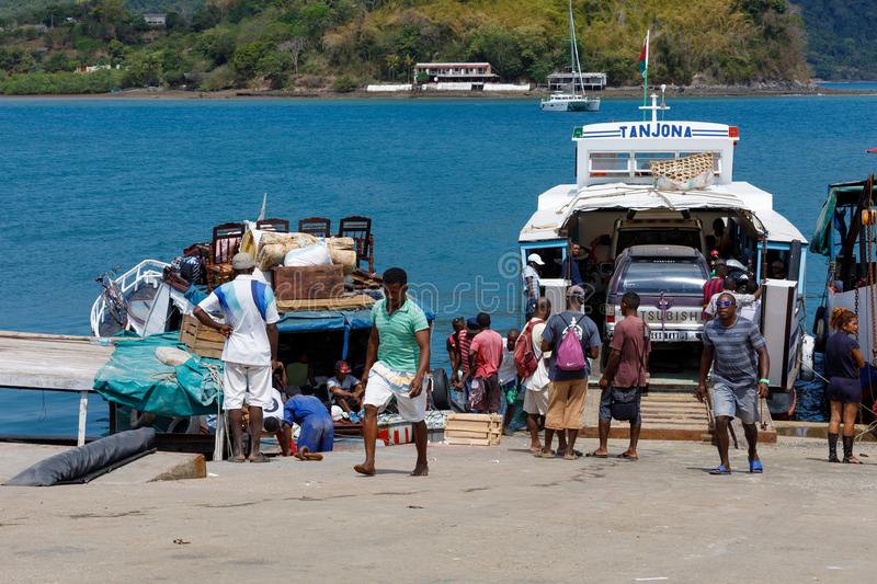 Malagasy peoples loading ship in Nosy Be, Madagascar stock photography