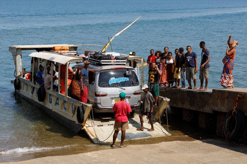 Malagasy peoples loading ship in Nosy Be, Madagascar royalty free stock photos