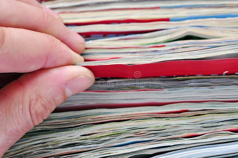Notícia. compartimentos de papel da leitura fotografia de stock royalty free