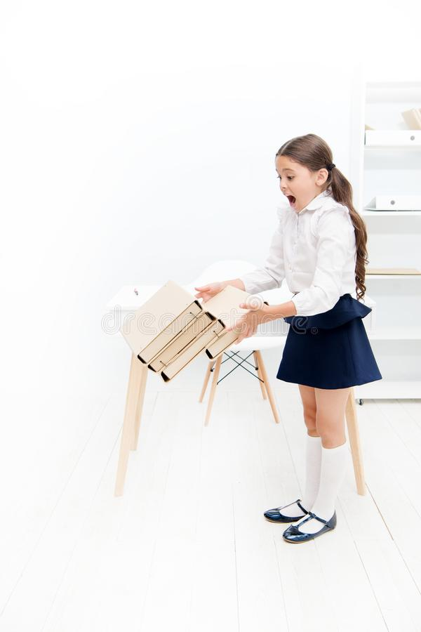 Only not this. back to school. shouting girl with workbook folders. Education. heavy documents. Towards knowledge. small. Girl in school uniform. lot of royalty free stock images