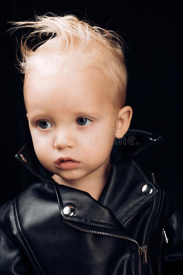 Not calm listen to rock. Adorable small music fan. Music for children. Little rock star. Little child boy in rocker. Jacket. Rock style child. Rock and roll royalty free stock photos