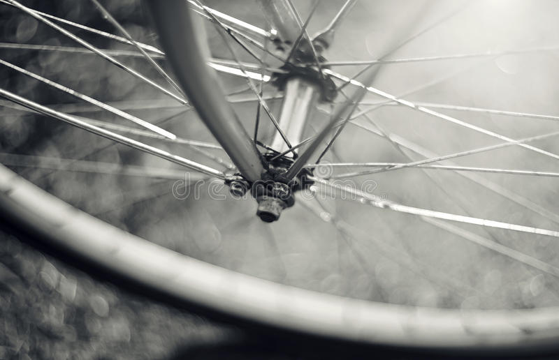 Not the color image of a wheel of the bicycle with bokeh royalty free stock photography