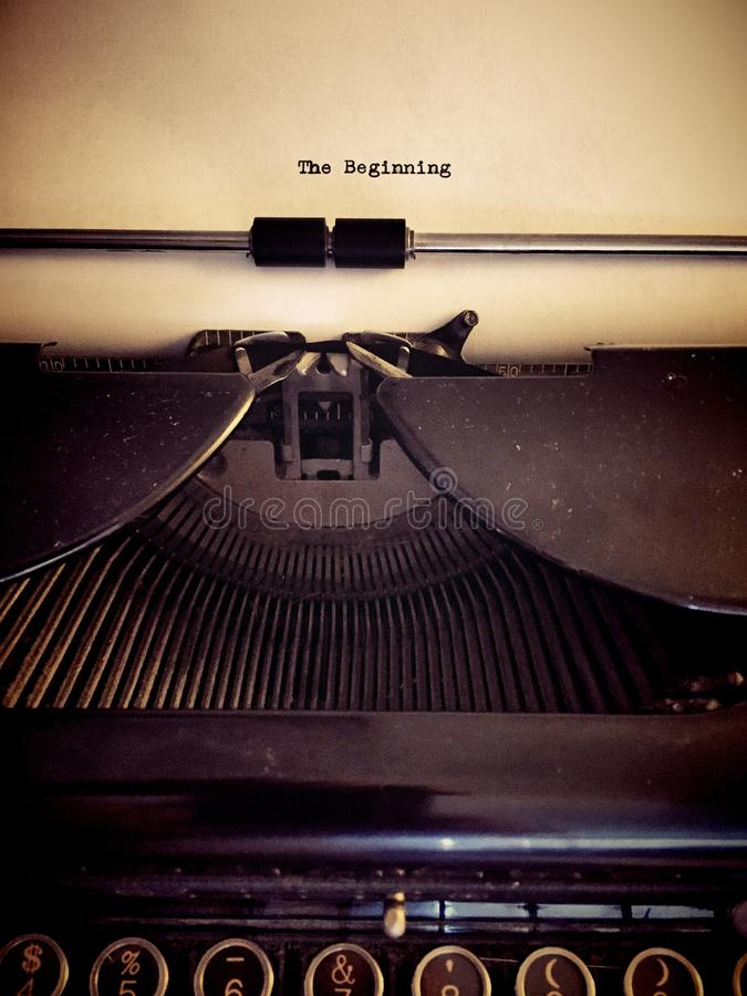Not The End. Page in vintage typewriter with 'The Beginning' typed on paper stock images
