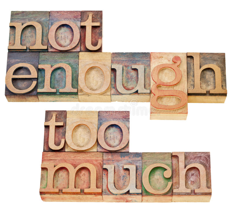 Not enough, too much. Supply and demand or consumerism concept - a collage of isolated text in vintage wood letterpress printing blocks stock images