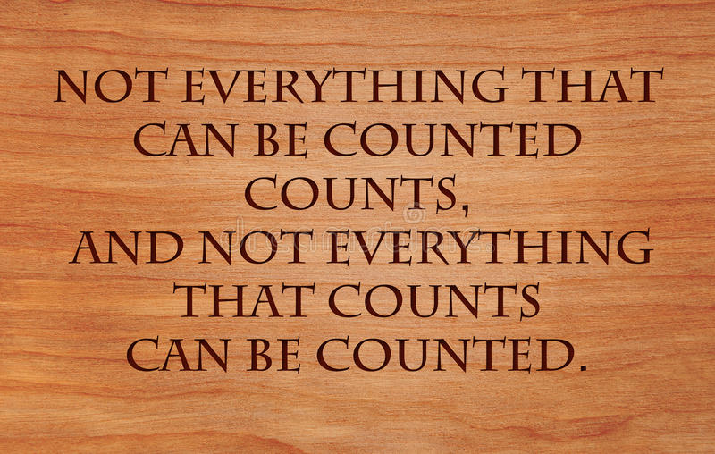 Not everything that can be counted counts. And not everything that counts can be counted - quote by Albert Einstein on wooden red oak background stock image