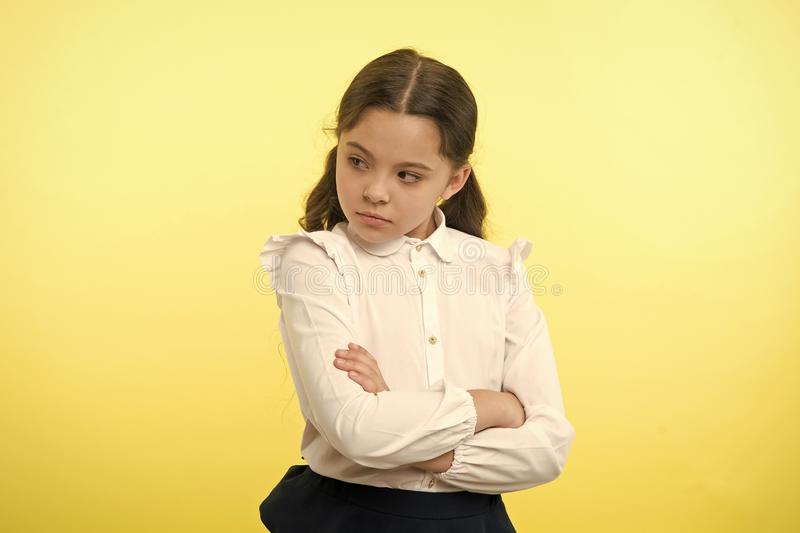 That is not fair. Pupil not agree with mark. Girl serious face offended yellow background. Kid unhappy looks strictly royalty free stock photography
