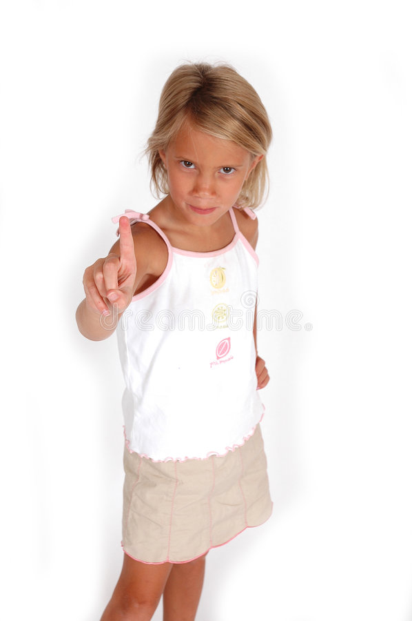 Not so Fast. Little girl stands with her one index finger pointing in the air. Indicating the number 1, to stop, hold on or slow down royalty free stock photo