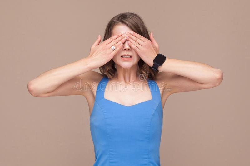 Not interesting. Woman in blue dress closed eyes her hands royalty free stock photo
