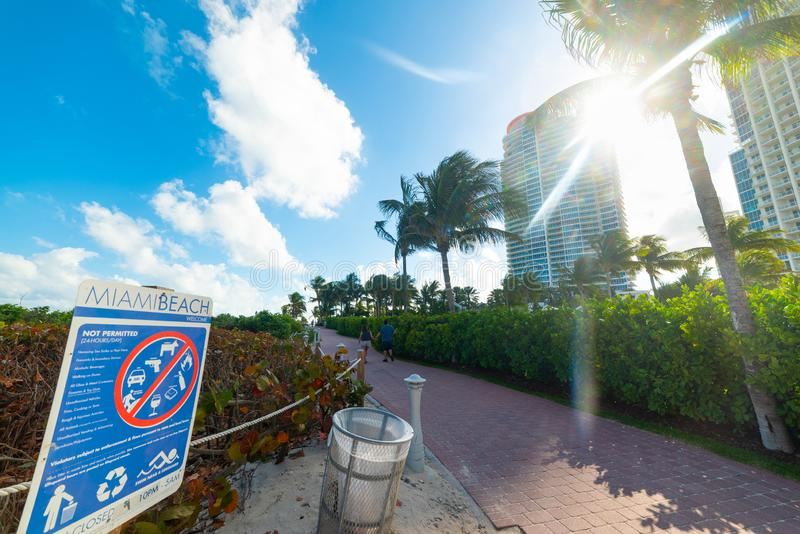 Not Permitted sign at beach entrance. Miami Beach, USA - February 19, 2019: Not Permitted sign at beach entrance, america, south, florida, prohibition stock images