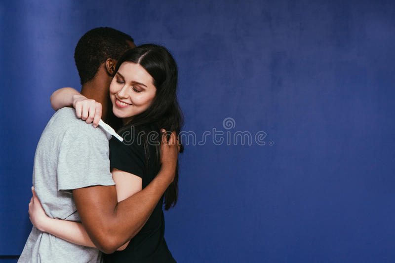 We are not pregnant. Happy couple hug with relief. stock images