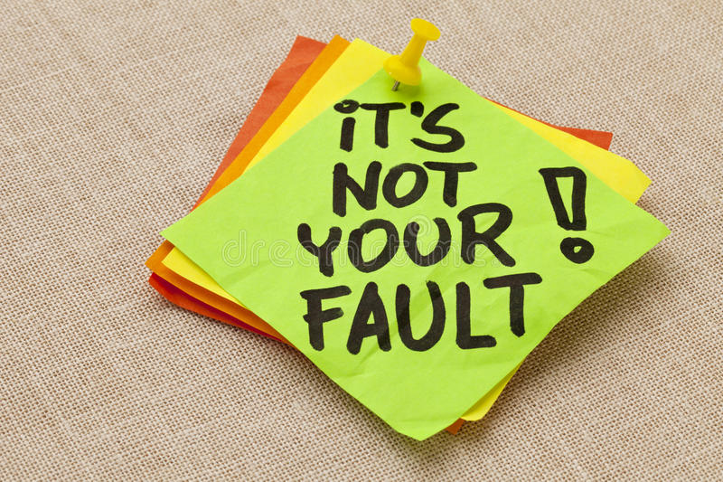 It is not your fault. Motivational concept - It is not your fault exclamation - handwriting on a green sticky note against canvas board stock photos