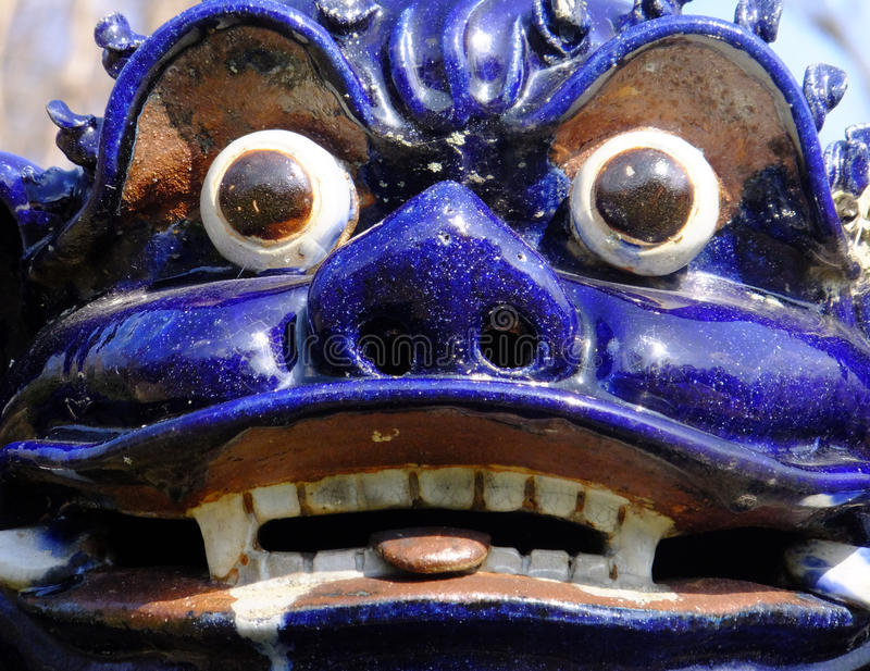 Not Your Pretty Face. Purple porcelain Fu Dog at Allerton Park, Monticello, IL which was gifted to the University of Illinois in 1946 and registered as a royalty free stock photos