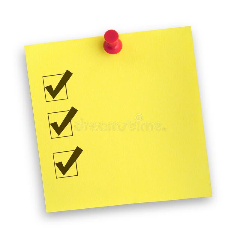 Nota con la lista de comprobación terminada imagen de archivo libre de regalías