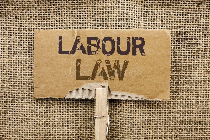 Nota da escrita que mostra a lei Labour O emprego apresentando da foto do negócio ordena a legislação o escrito união das obrigaç foto de stock