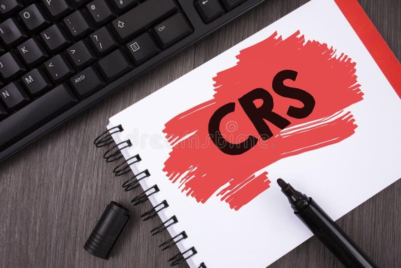 Nota de la escritura que muestra el CRS Foto del negocio que muestra el estándar común de la información para compartir la inform fotos de archivo libres de regalías