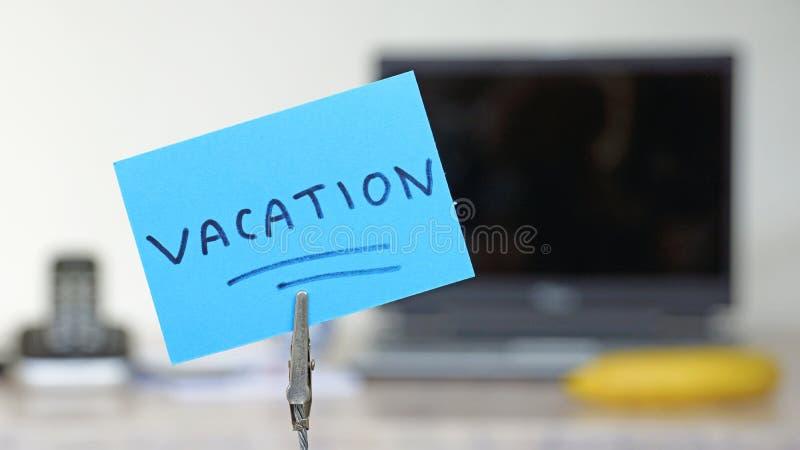 Nota de las vacaciones foto de archivo