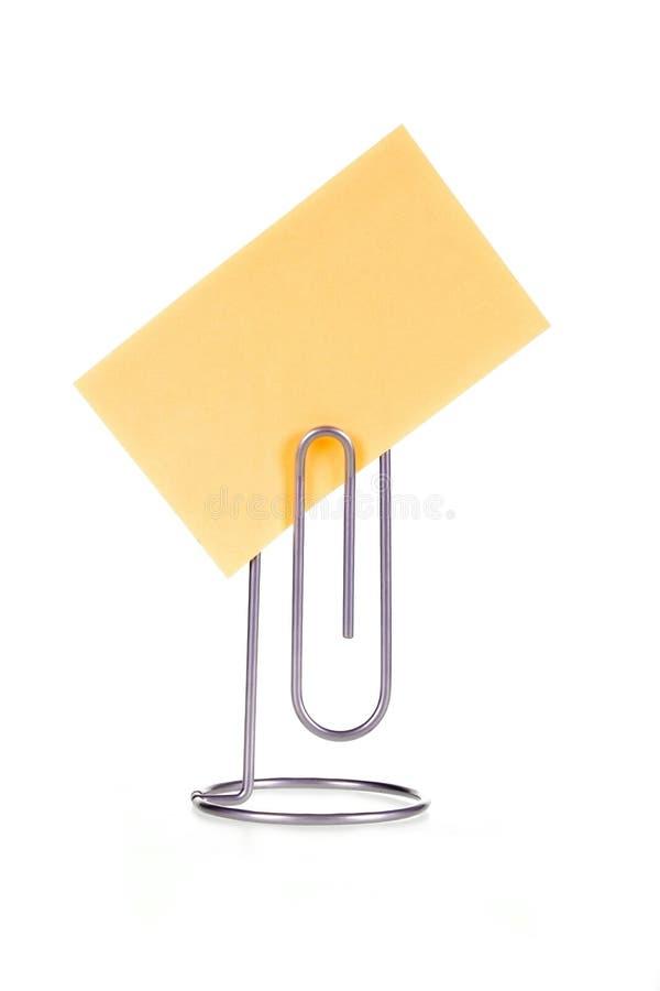 Nota de papel sobre sostenedor de la nota imágenes de archivo libres de regalías