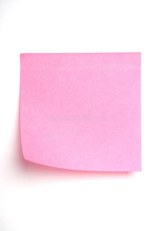 Nota de post-it rosada aislada en blanco fotografía de archivo