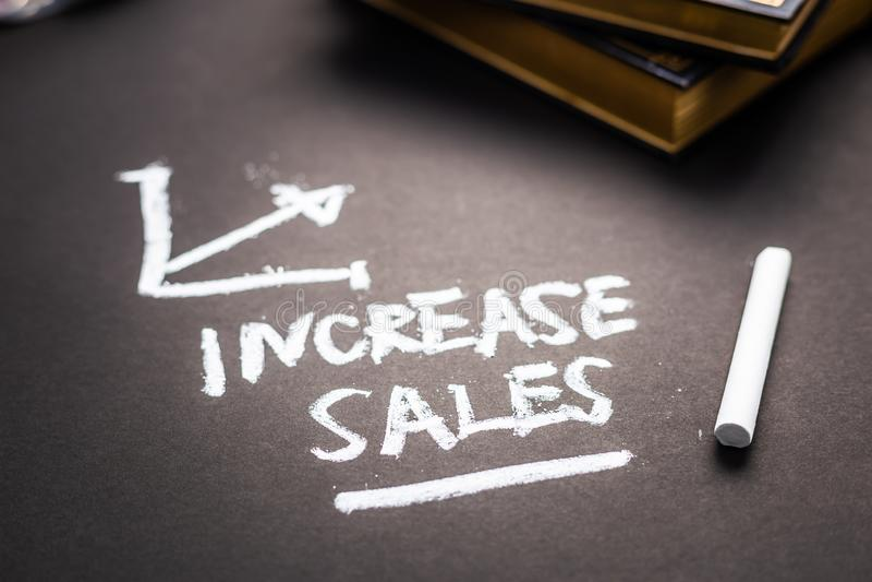 Nota de ventas del aumento fotos de archivo libres de regalías