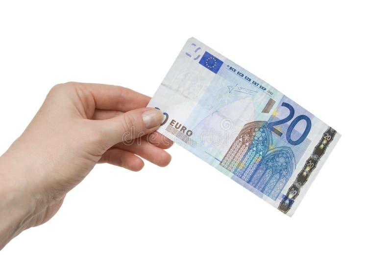 nota dell'euro 20 in una mano femminile fotografia stock