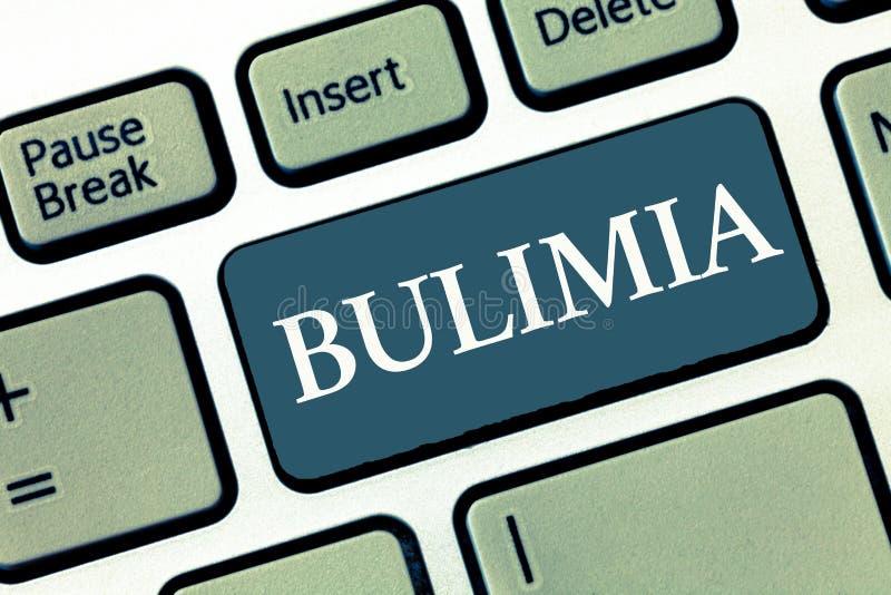 Nota di scrittura che mostra bulimia Foto di affari che montra ossessione estrema di ottenere disturbo psichico di peso eccessivo immagine stock