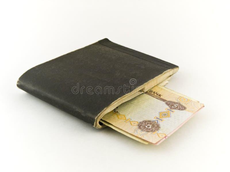 Nota do Chequebook velho e dos cinco dirhams em Backg branco fotografia de stock royalty free