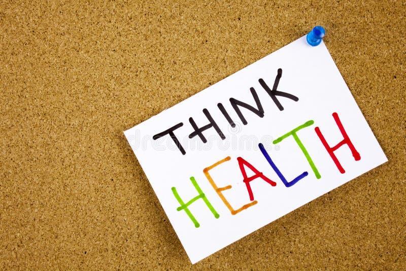 A nota do memorando fixada a um quadro de mensagens da cortiça como o lembrete pensa a saúde imagens de stock