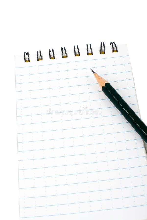 Nota e matita del blocco fotografia stock