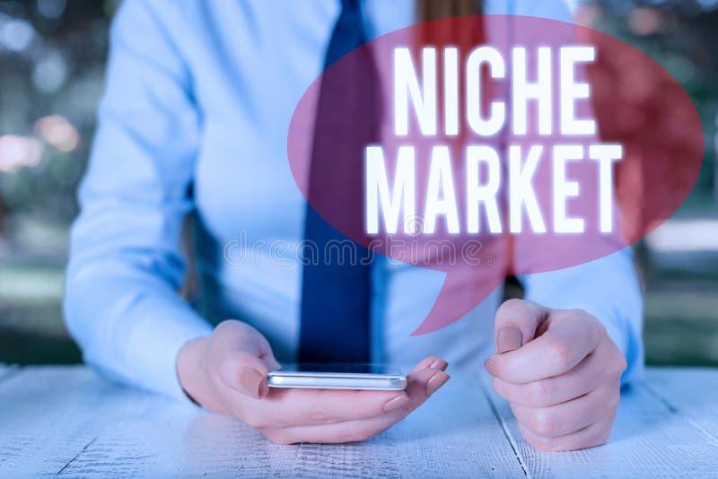 Nota escrita mostrando Niche Market Apresentação de fotos da empresa Subconjunto do mercado no qual o produto específico está foc fotografia de stock royalty free