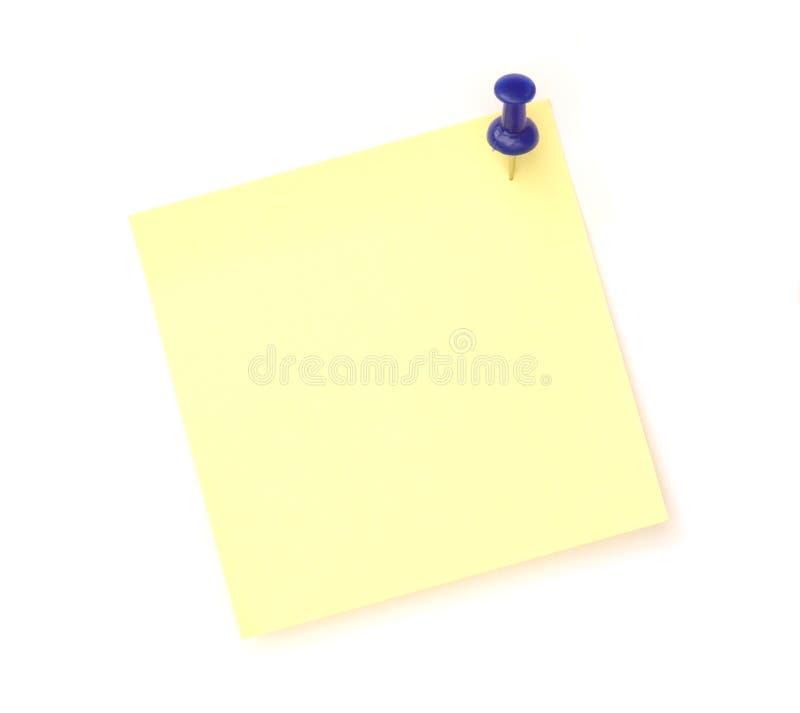 Nota gialla sopra priorità bassa bianca fotografia stock libera da diritti