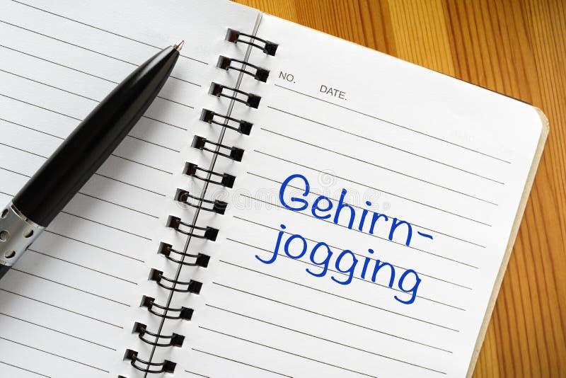 Nota no idioma alemão: Gehirnjogging imagens de stock