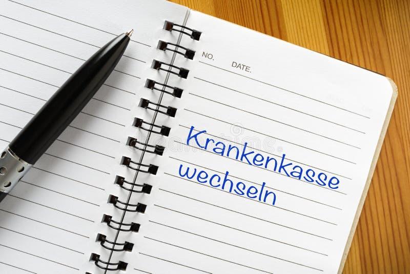 Nota no idioma alemão: Wechseln de Krankenkasse imagens de stock royalty free