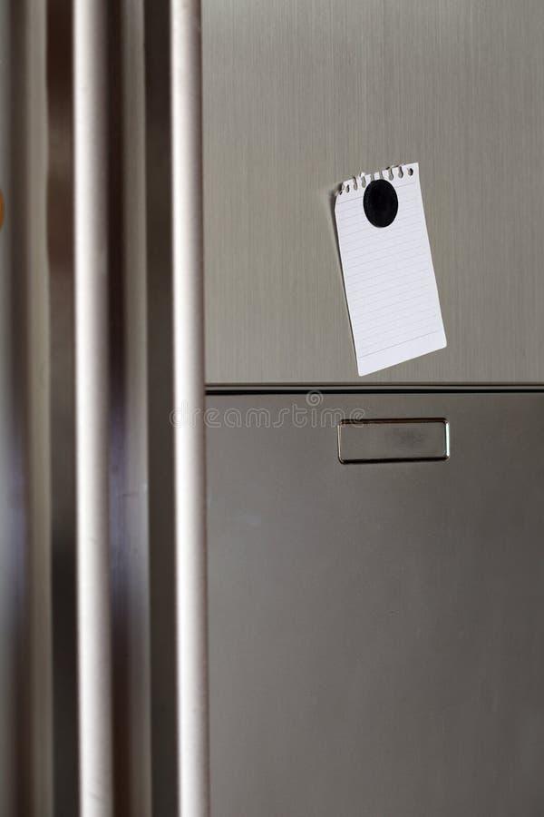 Nota no refrigerador imagens de stock