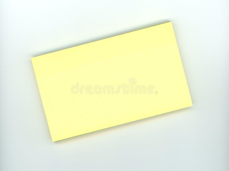 Nota pegajosa amarilla en blanco imagenes de archivo
