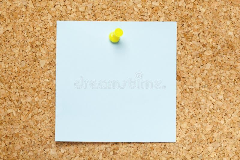 Nota pegajosa azul en blanco imagenes de archivo
