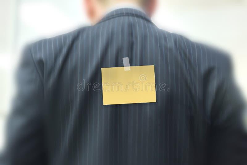 Nota pegajosa no homem de negócios fotografia de stock