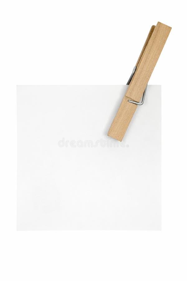Nota y Clothespin blancos fotos de archivo libres de regalías