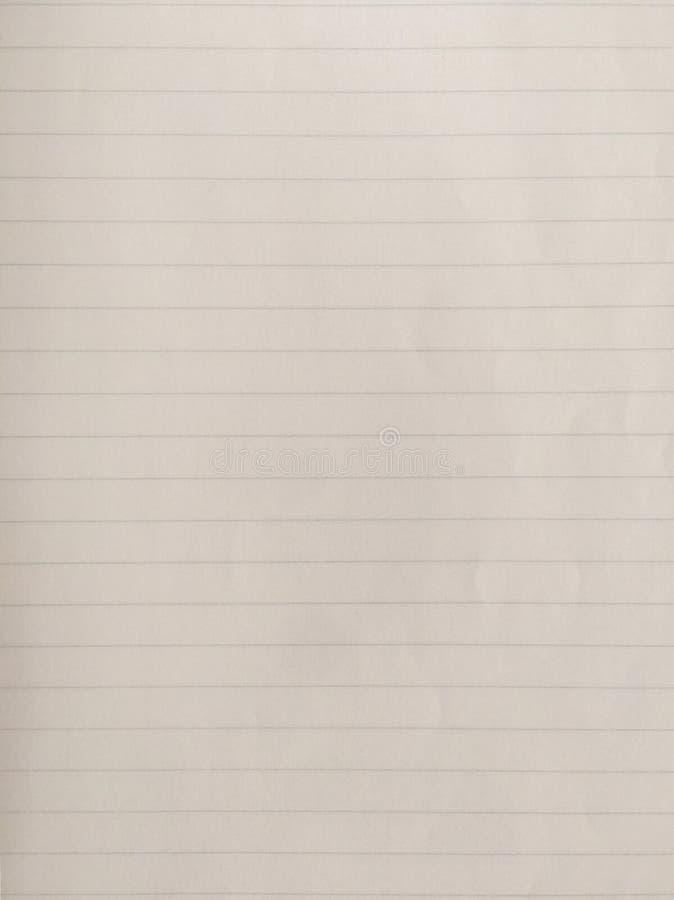 Notablad met blauwe lijnen stock foto