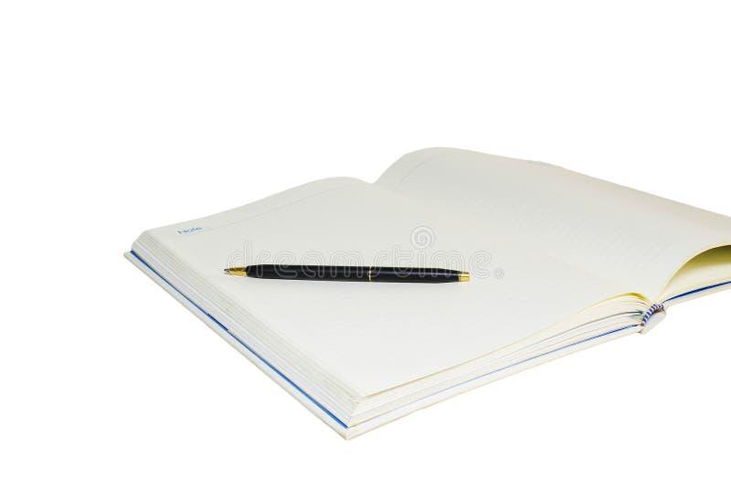 Notaboek en pen op witte achtergrond stock afbeeldingen