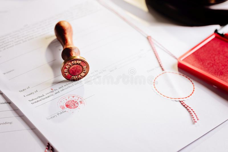 Notary public metal stamper on testament. royalty free stock images