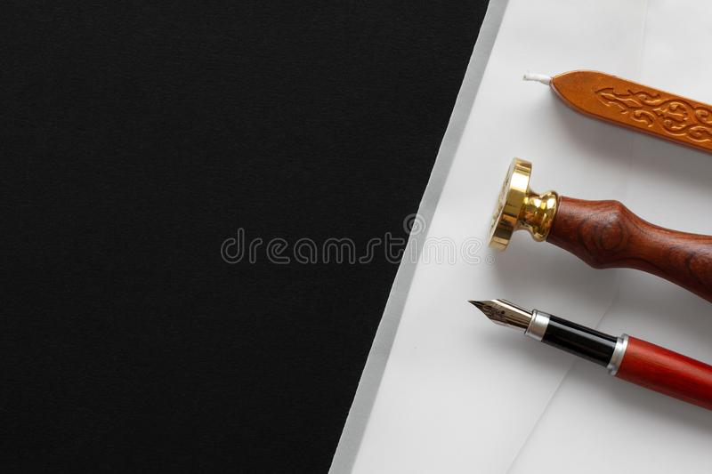 Notary public wax stamper. White envelope with brown wax seal, golden stamp. Responsive design mockup, flat lay. Still life with stock images