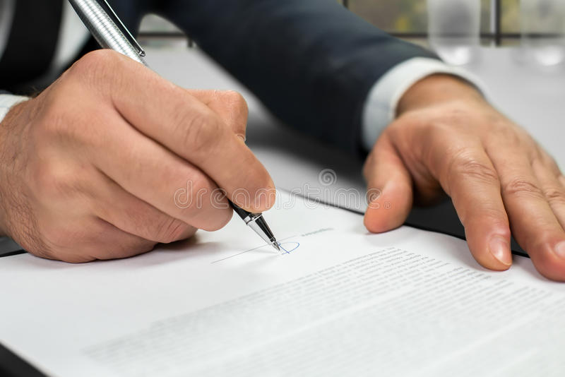 Notary's hands doing daytime paperwork. Notary signing papers near window. Read everything carefully. Time to make conclusions royalty free stock images