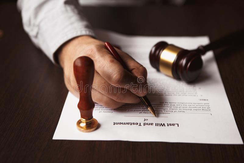 Notary`s public pen and stamp on testament and last will. Notary`s public pen and stamp on testament royalty free stock images