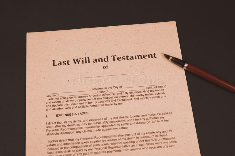 Notary`s public pen and stamp on testament and last will. Notary public. Tools royalty free stock photos
