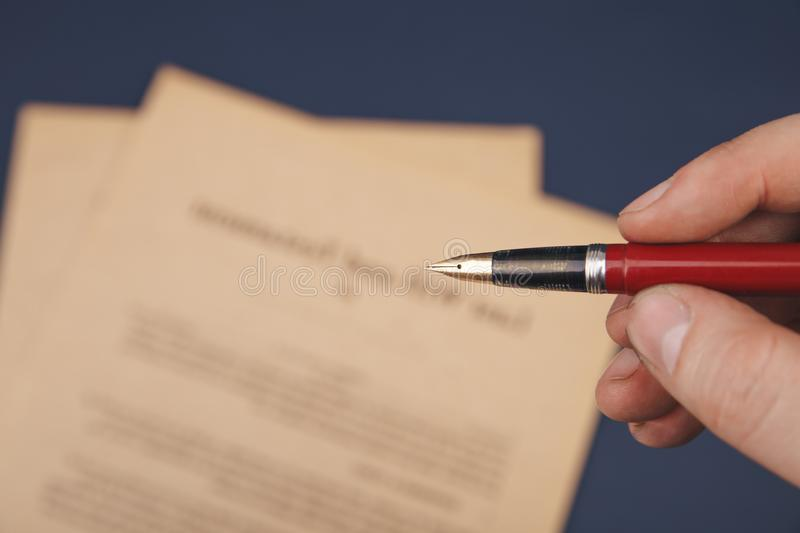 Notary`s public pen and stamp on testament and last will. Notary public. Tools stock photo