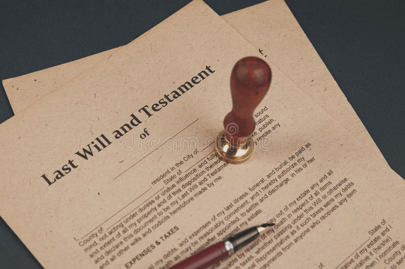 Notary`s public pen and stamp on testament and last will. Notary public. Tools royalty free stock image