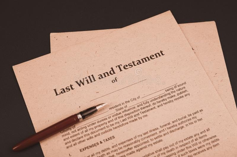 Notary`s public pen and stamp on testament and last will. Notary public. Tools royalty free stock photo